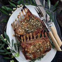 Garlic-Crusted Roast Rack of Lamb | Kenny Rochford's favorite way to prepare a rack of lamb is to simply rub it with plenty of garlic, rosemary, olive oil and salt before roasting.