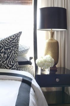 Black and white and pattern. Brass touches.