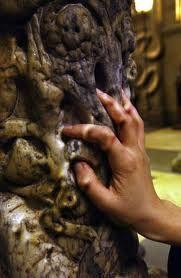 A pilgrim touching the feet of Santiago de Compostela, in the cathedral of Santiago de Compostela.