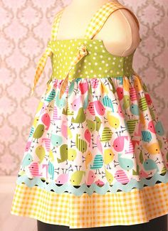 Spring Knot dress...too cute! I would probably put the knots in the back o the dress.