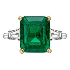 Cartier 4.99 Carat Colombian Emerald Diamond Ring. Colombian emerald and diamond ring, centering on an octagonal-shaped step-cut emerald weighing 4.99 carats, flanked by tapered baguette-cut diamond shoulders, mounted in platinum with an 18k yellow gold central basket, numbered 78739, signed Cartier.