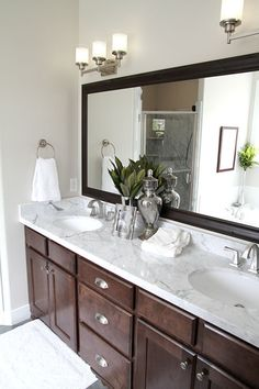 This bathroom is so classic and the mix of light materials + dark materials = Fabulous!