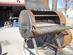 """This is my first smoker project. This was a fun project for never having welded before. I used a Lincoln Power Mig 256. I am trying to find someone to do a high heat powdercoat on it. That is the only photos I dont have. I did find out that on this type of project you really need a 7"""" angle grinder. I had a 4 1/2"""" but it just took too long to grind the welds and edges down. I have done two briskets and about 5-6 racks of ribs and a few chick..."""