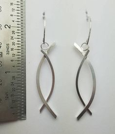 Handmade Sterling silver under over wave earrings.