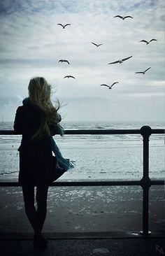 Bird watching sky girl ocean clouds birds alone fly windy