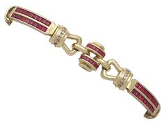 '2.04 ct Ruby and Gold Bracelet with Diamond - Vintage French' http://www.acsilver.co.uk/shop/pc/2-04-ct-Ruby-and-0-45-ct-Diamond-18-ct-Yellow-Gold-Bracelet-Art-Deco-Vintage-French-Circa-1940-35p9308.htm