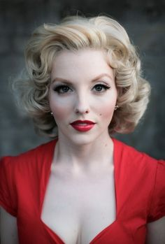 1950s #2 pale face again, heavily blushed cheeks and that all important pair of the cat eye flick and bold red lip!