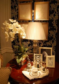 Ralph Lauren bedside table-black and tan wallpaper