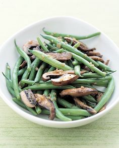Fresh green beans and meaty portobello mushrooms are sauteed with shallots to make a quick, attractive side dish. You can substitute any variety of mushrooms you like in this recipe.
