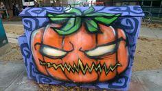 Brighton street art / graffiti: Halloween pumpkin on a BT junction box