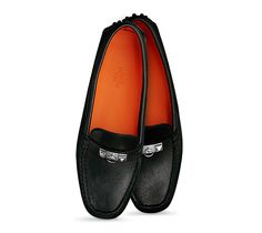 """Irving, Hermes ladies' driving moccasin in black calfskin, very supple, 2 """"Clous Pyramides"""" hardware in palladium plated, orange lining, pyramidal rubber studs on the sole"""