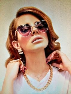 Lana Del Rey wearing some cute metal heart sunglasses