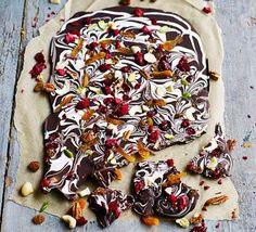 This super-simple slab of swirled dark and white chocolate is studded with chopped mixed nuts and dried fruit - break into chunky shards and pop in a homemade hamper as an edible gift