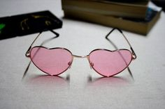 We're thinking that we need a pair of pink heart shaped glasses.