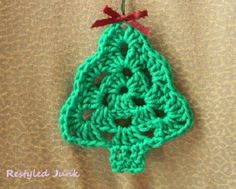 Granny triangle Christmas tree ornament to crochet. There isn't a pattern but it looks pretty easy to figure out from the picture