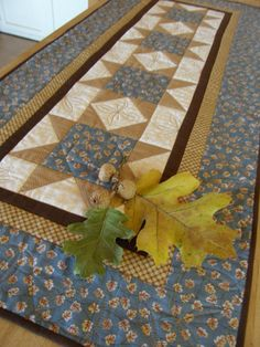 Quilted Table Runner - SAWTOOTH STARS in Blue and Tan. $35.00, via Etsy.