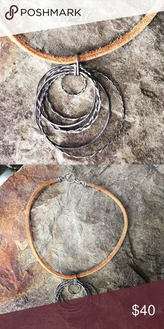 """Sterling ring necklace Various Sterling silver hoops in a möbius style. Largest ring about 2"""". Super soft leather cord necklace. Very neutral and versatile. IEdesigned Jewelry Necklaces"""