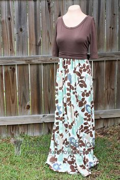 Use a tshirt in your closet to make an empire waist maxi dress. Ties in the back to cinch it in. Gathers at the front center and back center but not the sides so it eliminates bulk. Cute!