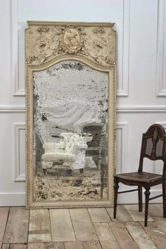 MIRROR, large, antique and leaning.