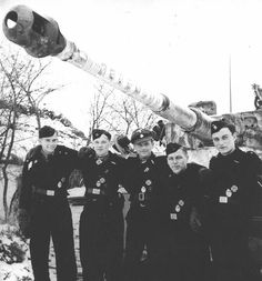"""One of Germany's most successful tankaces Michael Wittmann with his crew and Panzerkampfwagen VI Ausführung E """"TIGER"""""""