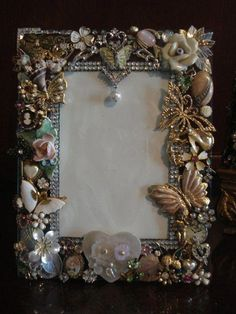 frame made from vintage costume jewelry. by - Beautiful frame made from vintage costume jewelry. by -Beautiful frame made from vintage costume jewelry. by - Beautiful frame made from vintage costume jewelry. Costume Jewelry Crafts, Vintage Jewelry Crafts, Vintage Costume Jewelry, Vintage Costumes, Craft Jewelry, Vintage Jewellery, Antique Jewelry, Jewellery Shops, Jewellery Box