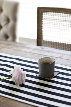 Love a striped runner. Such a pop of pretty on a rustic table. Behind the Blog with The Effortless Chic  Read more - http://www.stylemepretty.com/living/2013/07/16/behind-the-blog-with-the-effortless-chic/