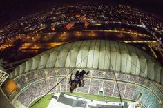 One of most amazing images in Nitro Circus Live history! Erik Roner BASE jumping off the top of the 350 foot arch over Moses Mabhida Stadium to kick off the sold out show in Durban last night. Nitro Circus, Base Jumping, Never Grow Up, Crazy People, South Africa, Arch, Past, Building, Amazing