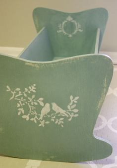 What a cute little shabby doll cradle. I'm loving this color.