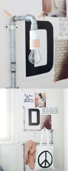 DIY Bedside Lamp / Rack using pipes. Really clever way to hide the wires, plus have a place to hang your book or magazine. #industrial #design #diy #sconce