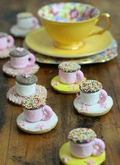 marshmallow and buttons/jazzies for the cup and iced biscuit for the saucer