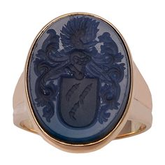French Antique Lapis Gold Signet Ring. Very large and handsome antique signet ring, set in 18K yellow gold. Beautiful well-detailed crest. Made in France circa 1890.