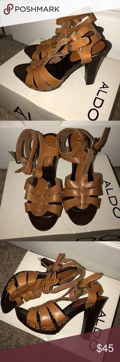 Sandals Brown wooden heels. Lighter brown straps. 4 inch heel. Comfortable. Aldo Shoes Sandals