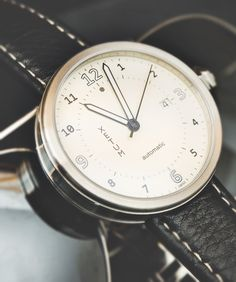 Xetum Men's Watch: Stinson with white dial and black leather strap.