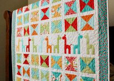 colorful giraffe patterned quilt