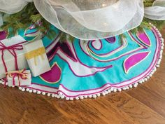 This year, forgo the usual holiday colors and embrace kicky bright hues and swirling patterns inspired by traditional Scandinavian designs. Felt, yarn and fabric glue are all you need to make this colorful Christmas tree skirt.