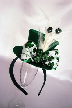St Patrick's Day Top Hat Headband, Green Felt, Shamrock Bow, Kiss Me I'm Irish, Feathers, Photo Prop, Fascinator, Adult, Ladies, Girls, Baby. $24.00, via Etsy.   OH. DEAR. GOD.