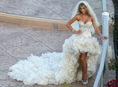 Joanna Krupa is off the market! What do you think of the reality star's mullet-style wedding gown?