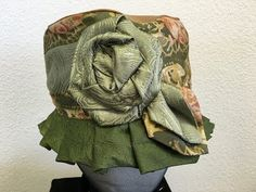 Artfully designed hats, bags and collars made from upcycled materials