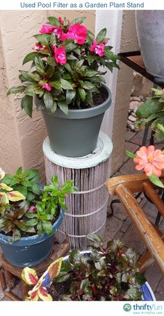 I hated to throw away our used swimming pool filter and thought it looked so interesting. I stood it upright and put a flower pot on top of it. It adds prominence to an empty space in the garden.