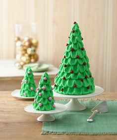 """A holiday centerpiece you also serve for dessert! Decorate this """"forest"""" of Christmas trees with small colorful candy """"ornaments,"""" or layer with white frosting for a snow-covered look."""