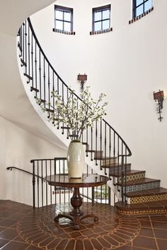 Mediterranean entry with iron banister  railing that isn't too busy but still very sophisticated - By: Dayna Katlin Interiors in Encino, California