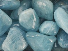 The color associated with the Aquamarine is transparent blue or sea-green. Description from bloomlashowroom.com. I searched for this on bing.com/images.   Possibly Maybe these rocks?