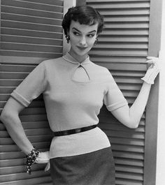 """Demurely collared, but boasting an attractive peek-a-boo neckline, Catalina's attractive sweater top is a suit or skirt favorite all winter long. Done in pastel shades of fine zephyr wool, the pretty top is daintily trimmed in white at the edges of collar and cuffs, 1954."" #vintage #fashion #1950s"