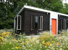 Charred cedar siding protects the tiny house from the elements.
