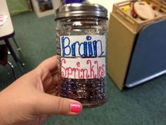 Give kudos to kiddos who work smart! These creative Brain Sprinkles can be made with a glass cheese shaker sealed shut with cardboard and glue, and a little bit of glitter and pom poms. Sprinkle on the student when he/she says something smart, is obeying, etc. Tip: Hit your local dollar store for deals on supplies.