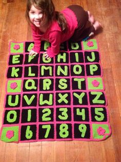 Crochet alphabet blanket, using Moogly's alphabet pattern attached to traditional granny squares.