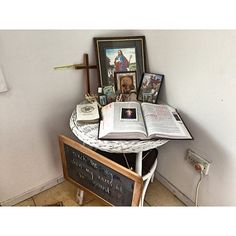 small home altar with Bible, cross, and images of Christ