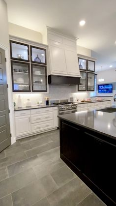 White kitchen with dark accents on doors and island - Open concept kitchen, dining room and living room with tall ceilings. Living Room Kitchen, Home Decor Kitchen, Home Kitchens, Small Kitchens, Dining Room, Dream Kitchens, Remodeled Kitchens, Renovated Kitchen, Basement Kitchen