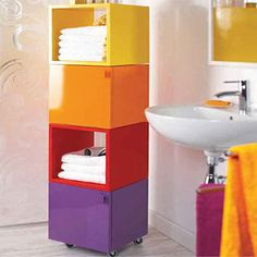 Use supawood cubes painted in bright colours to create a modular bathroom storage units