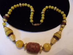 Czech 1920s era Art Deco necklace featuring Glowing Yellow Glass Beads with Brass spacers and Hand Carved Wood accents (or Bakelite?) | eBay